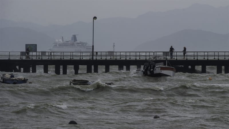 The waters around Hong Kong roughen as Typhoon Haima roars more than 100km to the east [Tengku Bahar/AFP]