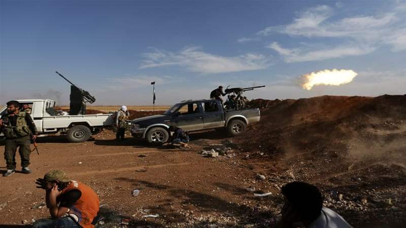 A Turkey-backed rebel fighter in Marea shoots towards Syria Democratic Forces (SDF) in Tel Rifaat [Khalil Ashawi/Reuters]