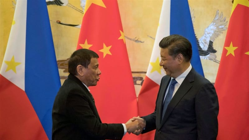 Philippine President Rodrigo Duterte and Chinese President Xi Jinping after a signing ceremony in Beijing, China [Reuters]