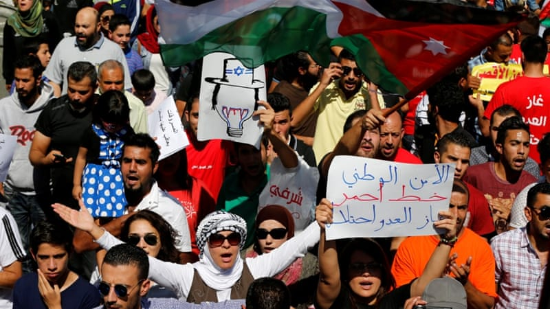 Thousands of Jordanians protested against the Israel-Jordan gas deal, holding placards reading 'National security is a red line. The enemy's gas is occupation' [Reuters]