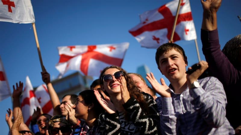 Supporters attend a pre-election rally of the largest opposition party United National Movement in Tbilisi, Georgia [REUTERS]