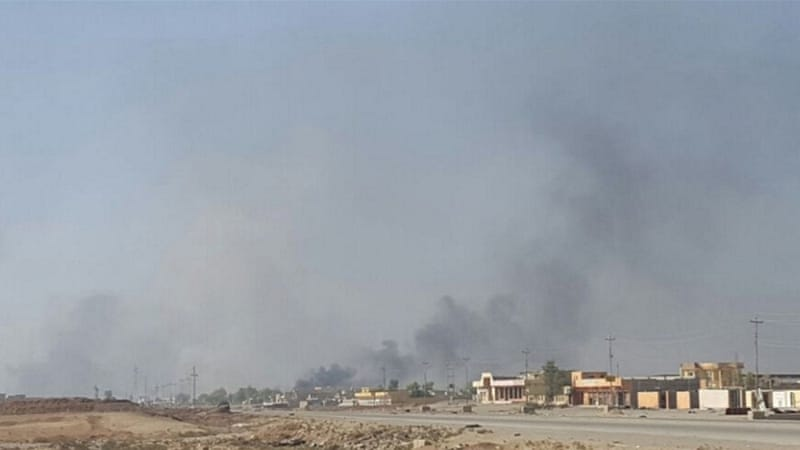 ISIL has been burning oil well and tyres in and around Mosul to try to obscure their position [Reuters]
