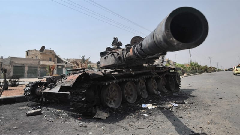 A destroyed Syrian government tank on a street near Aleppo, Syria, in July 2012 [EPA]