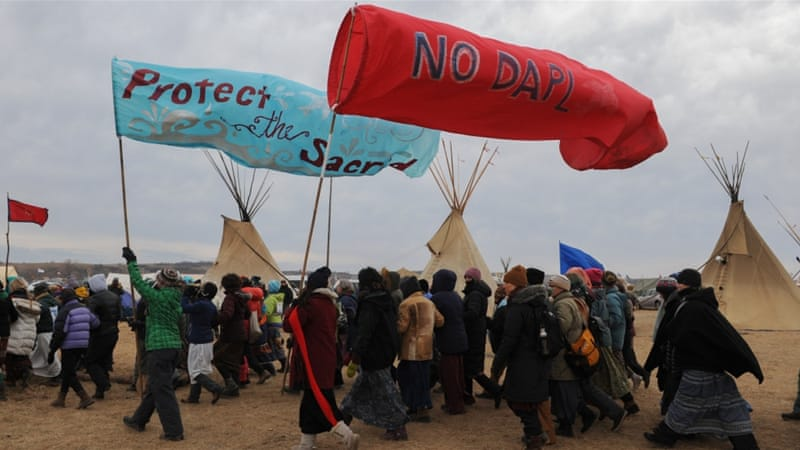 Hundreds of Native Americans and solidarity activists are camping to block a pipeline [Stephanie Keith/Reuters]