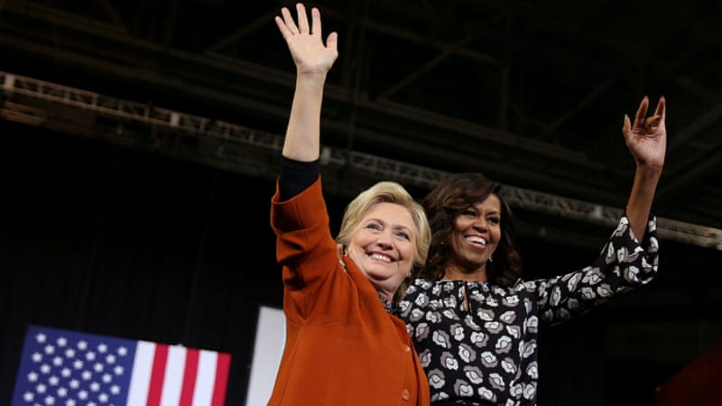 US Democratic presidential candidate Hillary Clinton arrives at a campaign rally accompanied by US First Lady Michelle Obama in Winston-Salem, North Carolina [Reuters]