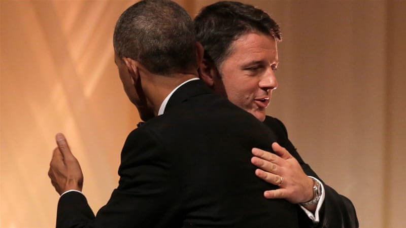 US President Barack Obama and Italian Prime Minister Matteo Renzi hug during an exchange of toasts at a White House state dinner  [Reuters]