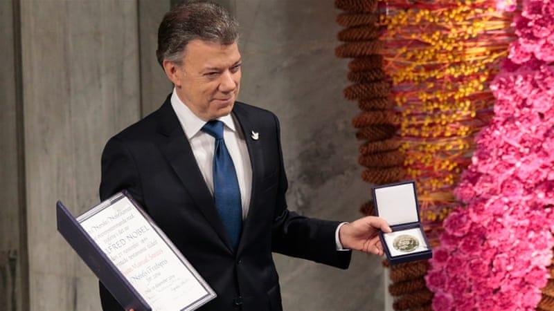 Santos accepts Peace Prize