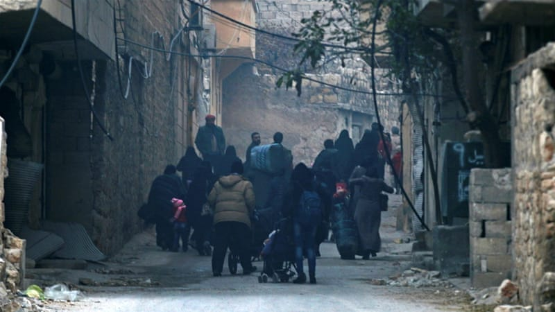 People carry belongings as they flee deeper into the remaining rebel-held areas of Aleppo [Reuters]