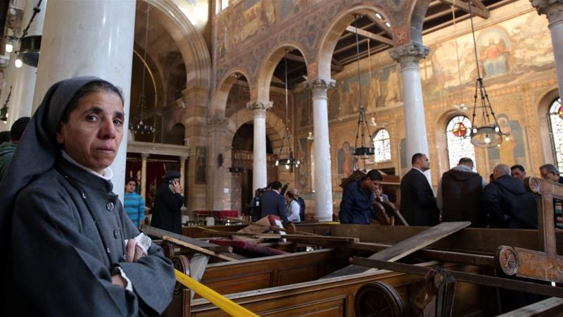 A nun stands inside the damaged St Peter's Coptic Orthodox Church after the bombing in Cairo [EPA]
