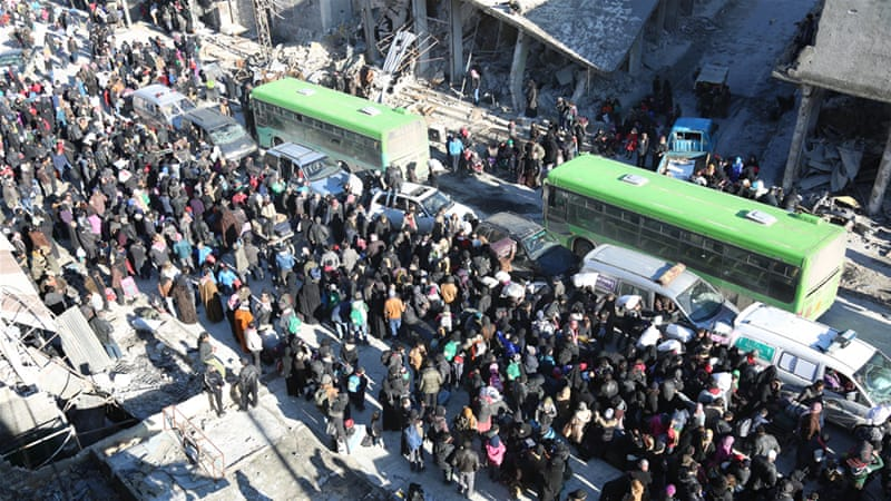 Aleppo residents prepare to get on to buses to take them out of the besieged city on December 15, 2016 [Malek al-Shimale/Al Jazeera]