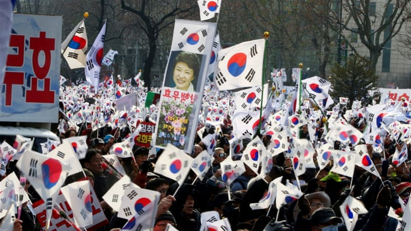 Many of President Park's supporters say the corruption allegations against her are politically motivated [EPA]