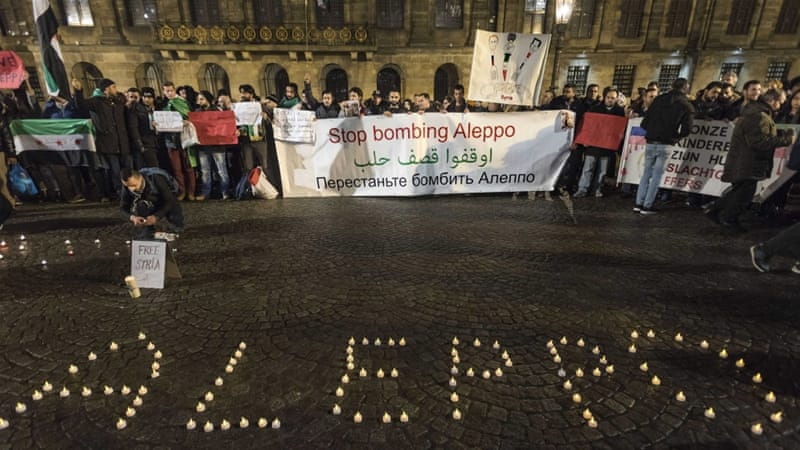 A candlelight vigil for the victims of the fighting in Aleppo is held in Dam Square in Amsterdam, the Netherlands [EPA]
