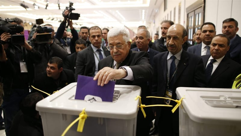 Palestinian President Mahmoud Abbas, centre, casts his vote at the seventh Fatah Congress on December 3 [EPA]