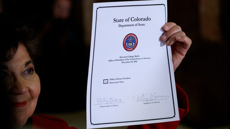 Colorado electoral college elector Senator Polly Baca displays her ballot after voting at the Denver State Capitol on December 19 [Rick Wilking/Reuters]