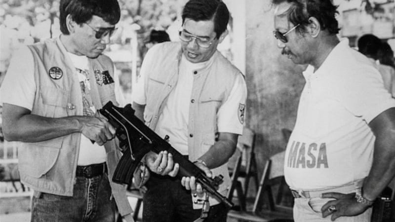 Duterte (L), Davao city mayor in the 1980s, has claimed to have killed people [Reuters]