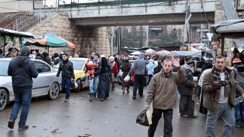 Residents of Aleppo ventured out a day before the ceasefire came into effect [EPA]