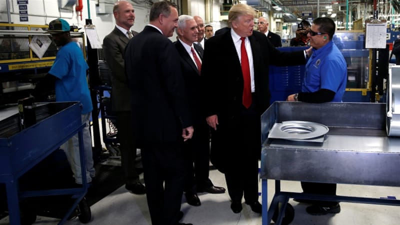 President-elect Donald Trump greets a worker as he tours a Carrier factory with Greg Hayes, CEO of United Technologies, left, in Indianapolis, Indiana, on December 1 [Reuters]