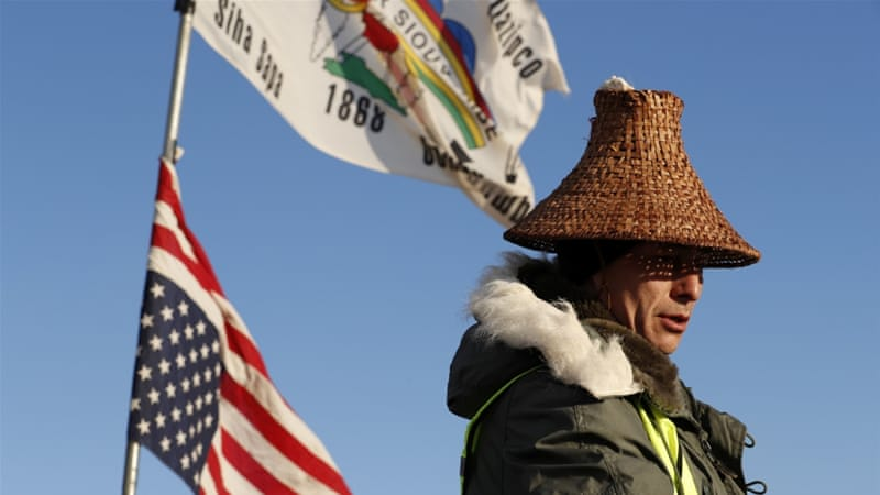 Activist Hugh Ahnatock of the Inupiaq tribe pauses after singing as demonstrations continued against pipeline project adjacent to the Standing Rock Indian Reservation, N Dakota, December 4 [Reuters]