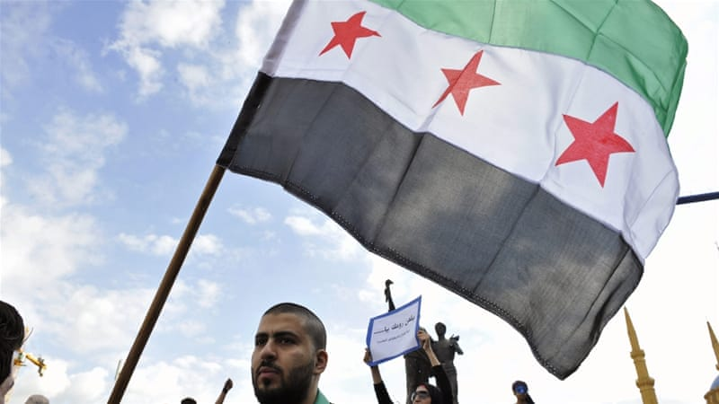 Lebanese and Syrian activists mark the fourth anniversary of the Syrian revolution against the regime of Bashar al-Assad, in Martyrs Square, downtown Beirut, Lebanon, on March 15, 2015 [Reuters]