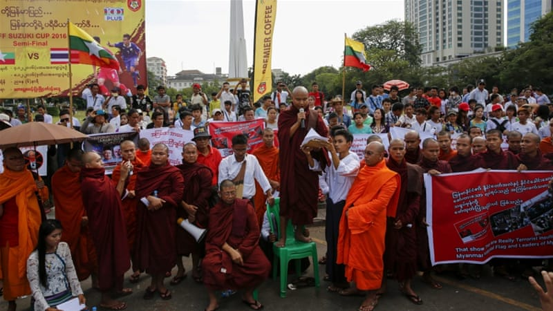 A group of about one hundred people gathered in front of Yangon City Hall in Myanmar on Sunday and demanded Malaysia to stop pressuring the Myanmar government over the Rohingya issue. [Lynn Bo Bo/EPA]-