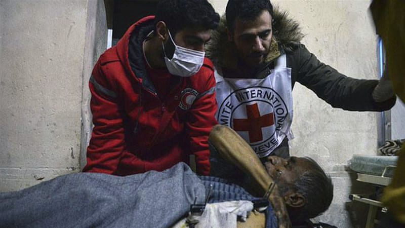 Health workers take a patient to a medical facility in the Old City of Aleppo [Noor Hazouri/AP]