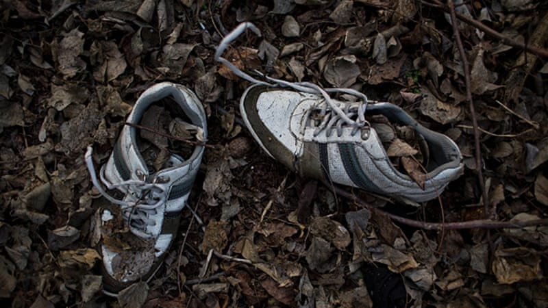 A pair of sneakers left by a refugee lies in the wood near the Hungarian-Serbian border [Getty]