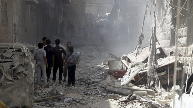 Syrian residents inspect damage from what activists said was a government air strike [Abdalrhman Ismail/Reuters]