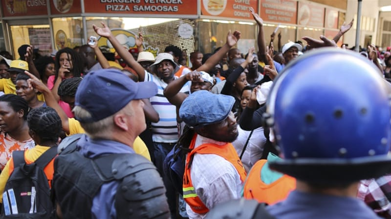 South African protesters clash with police before the opening of parliament ceremony in Cape Town [EPA]