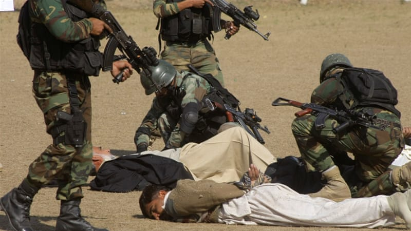 Pakistani army soldiers take part in a security drill at the Islamia College, in Peshawar, Pakistan [AP]