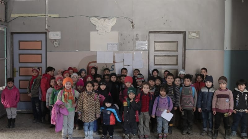 Despite the risk, students and teachers continue to go to school in dangerous Aleppo [Al Jazeera]