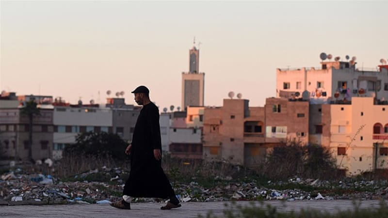 A Moroccan man walks in a street in the port city of Al-Muhammadiyah [AFP]