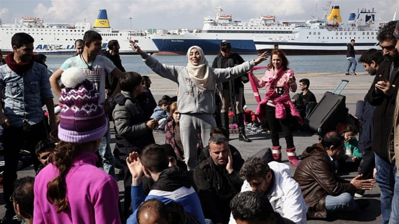 Syrian refugees shout slogans during a protest march in the port of Piraeus in Athens demanding the opening of the borders [EPA]