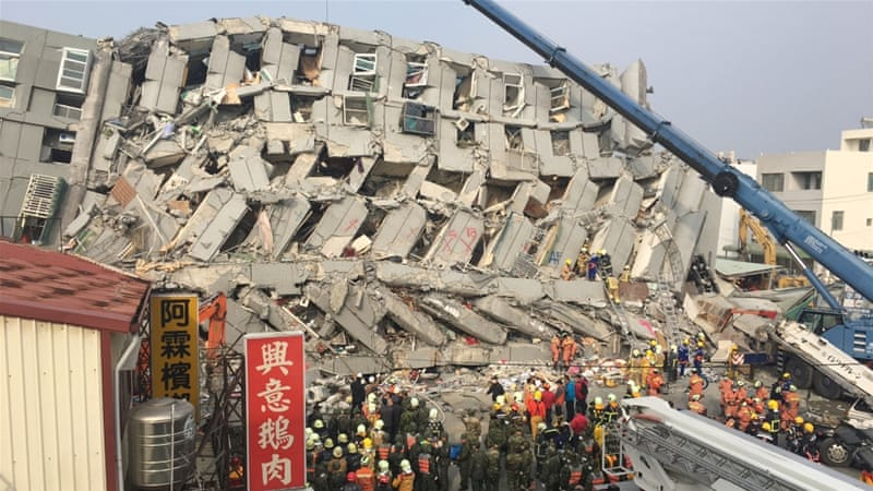 The 17-story Wei Guan building collapsed after a powerful quake stuck Tainan [Miguel Toran/Al Jazeera]