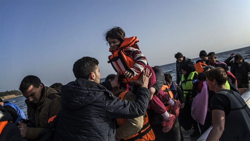 A Syrian man helps a girl to disembark from a dinghy after the arrival of refugees and migrants from the Turkish coast to Mytilene, Lesbos island, Greece. [AP]