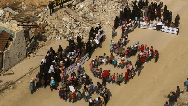 Aid convoy reaches Syrian town