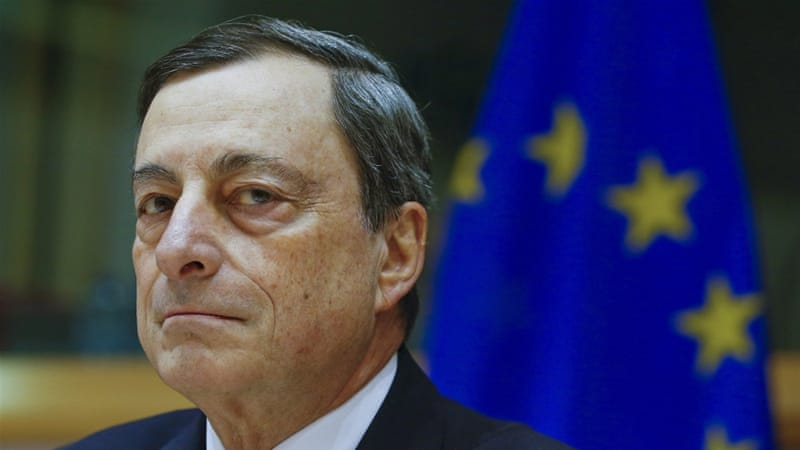 "ECB chief Draghi said the measures would ""reinforce"" the momentum of the eurozone economic recovery [Yves Herman/Reuters]"