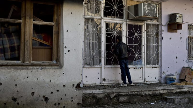 Cizre in ruins as Turkey lifts curfew on Kurdish towns