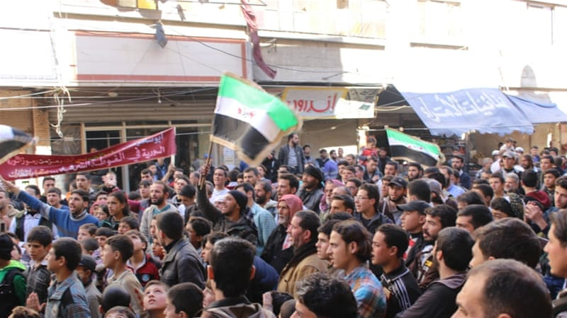 Hundreds of people poured into the streets of the Syrian village of Saqba for a protest march on Friday [Ward Mardini/Al Jazeera]