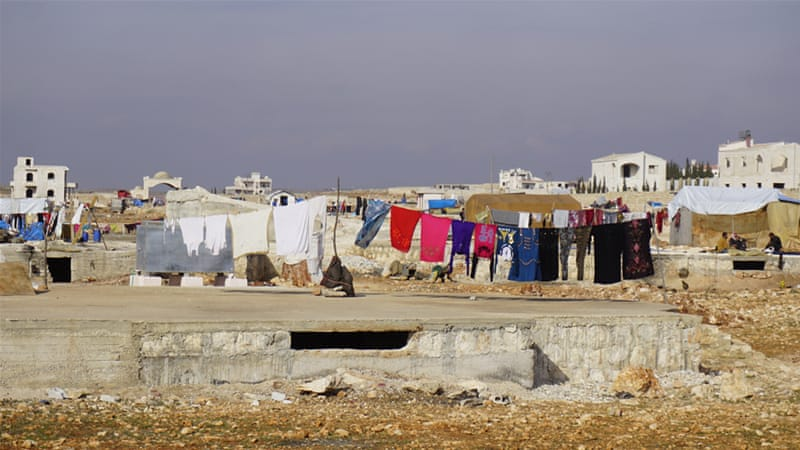 Junairi camp, which sits on a barren plot of land in Aleppo governorate, hosts about 1,500 internally displaced persons [Zouhir Al Shimale/Al Jazeera]
