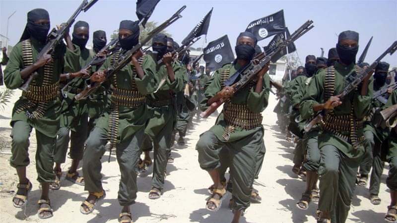 Al-Shabab fighters march with their weapons during military exercises on the outskirts of Mogadishu, Somalia [AP]