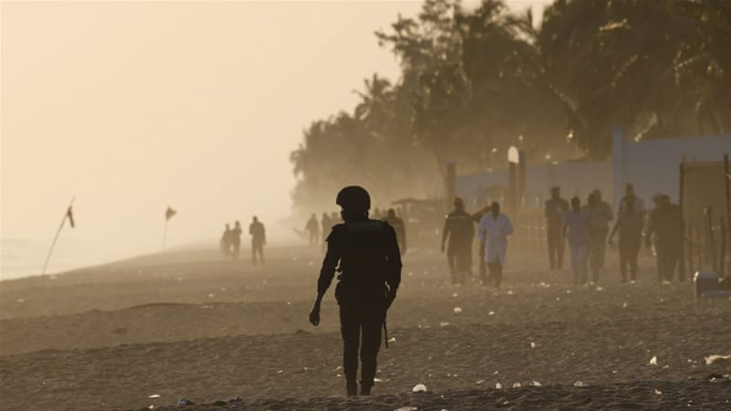 A security officer walks on the beach after an attack in Grand Bassam, Ivory Coast [Reuters]