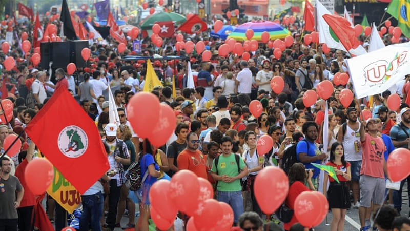 Tens of thousands have taken to the streets across Brazil to show support for President Dilma Rousseff and Lula [EPA]