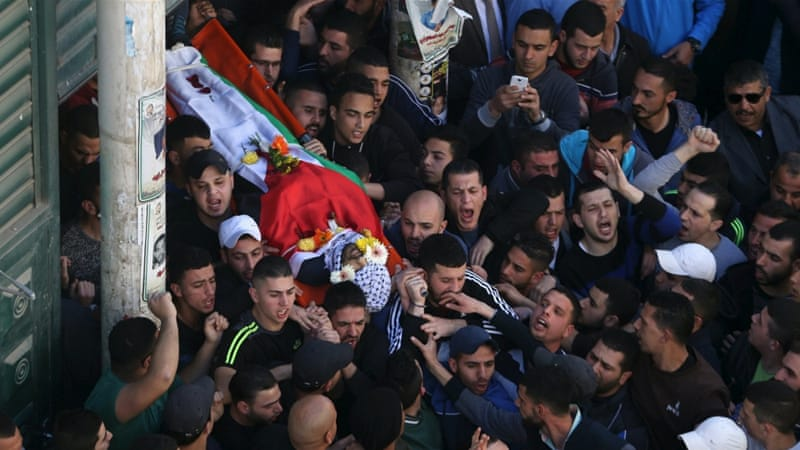 Residents of Qalandiya refugee camp buried a 22-year-old killed in clashes on Tuesday [Mohamad Torokman/Reuters]
