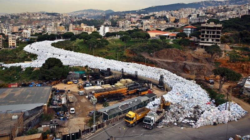 Rivers of rubbish have polluted Beirut since last summer [AP]