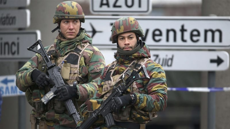 Belgian troops control a road leading to Zaventem airport following airport bombings in Brussels, Belgium [Reuters]