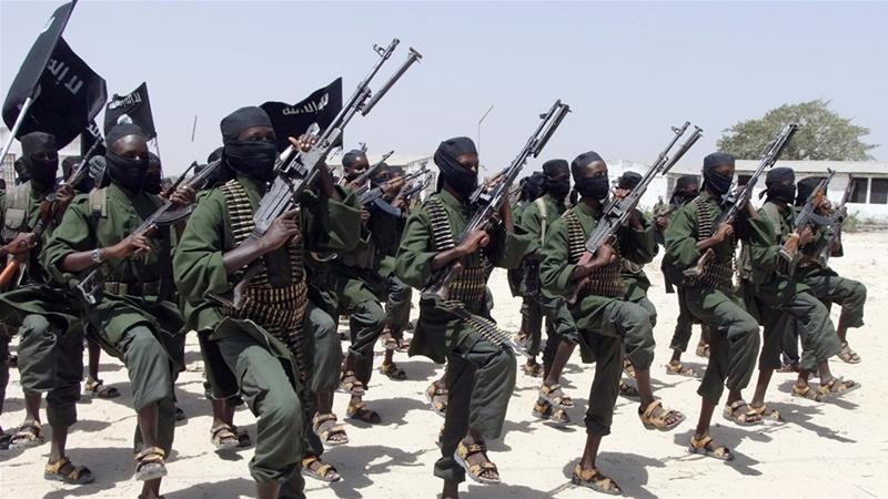 Al-Shabaab fighters perform military exercises in Somalia [File: Farah Abdi Warsameh/AP]