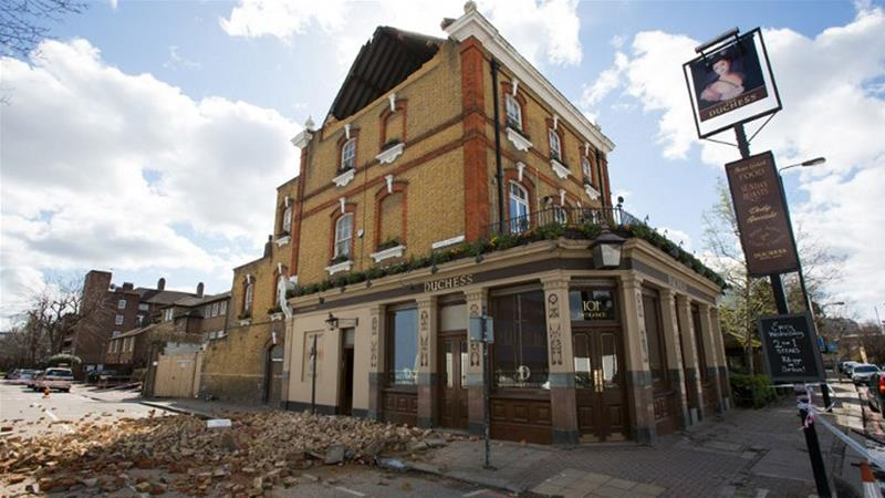 Storm Katie damages The Duchess pub in London's Battersea area [Daniel Leal-Olivas/AFP]