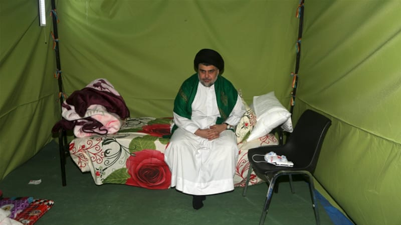 Iraqi Shia Muslim cleric Moqtada al-Sadr sits inside his tent during his sit-in inside the Green Zone in Baghdad [Wissm al-Okili/Reuters]