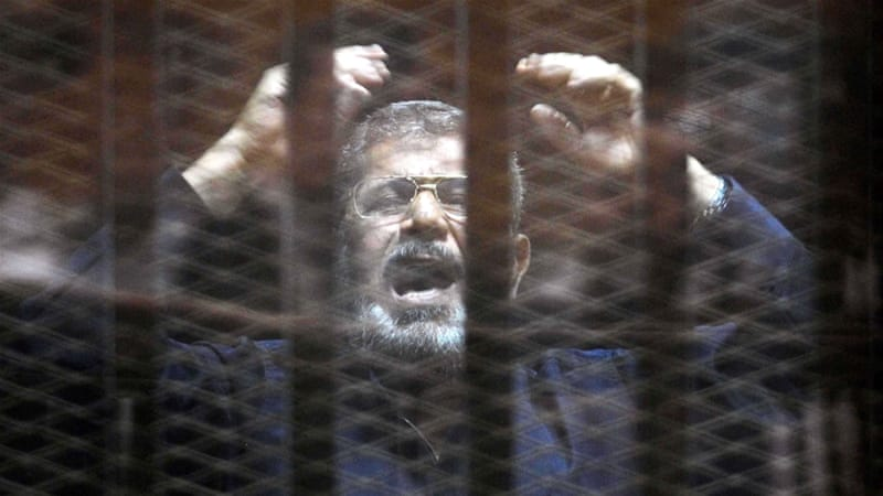Hundreds were sentenced to death or lengthy jail terms after speedy mass trials, including ousted President Morsi [Ali Malki/EPA]