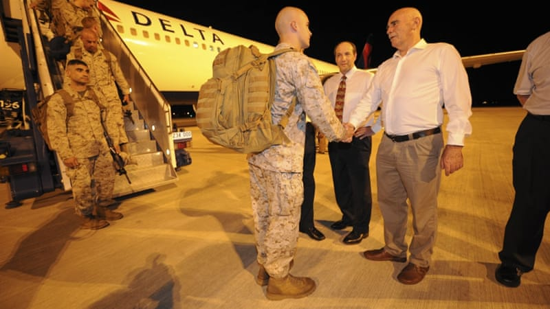 Captain Christopher Richardella of the United States Marines is greeted by Australia's former Defence Minister Warren Snowdon, right, upon arrival at a base in Darwin in 2012. [Reuters]